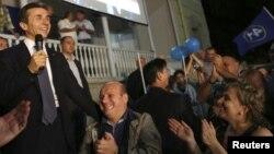 """Лидер оппозиционной коалиционной партии """"Грузинская мечта"""" Бидзина Иванишвили выступает перед своими сторонниками. Тбилиси, 1 октября 2012 года."""