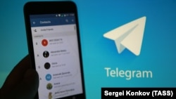Russia -- Telegram, a free cloud-based instant messaging service, running on a smartphone