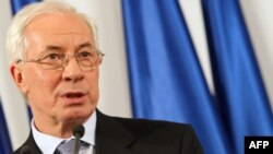Ukraine's newly appointed Prime Minister Mykola Azarov speaks to reporters today in Kyiv.