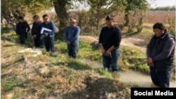 Local officials and farmers in the Tashkent region were forced to stand in a water-filled ditch.