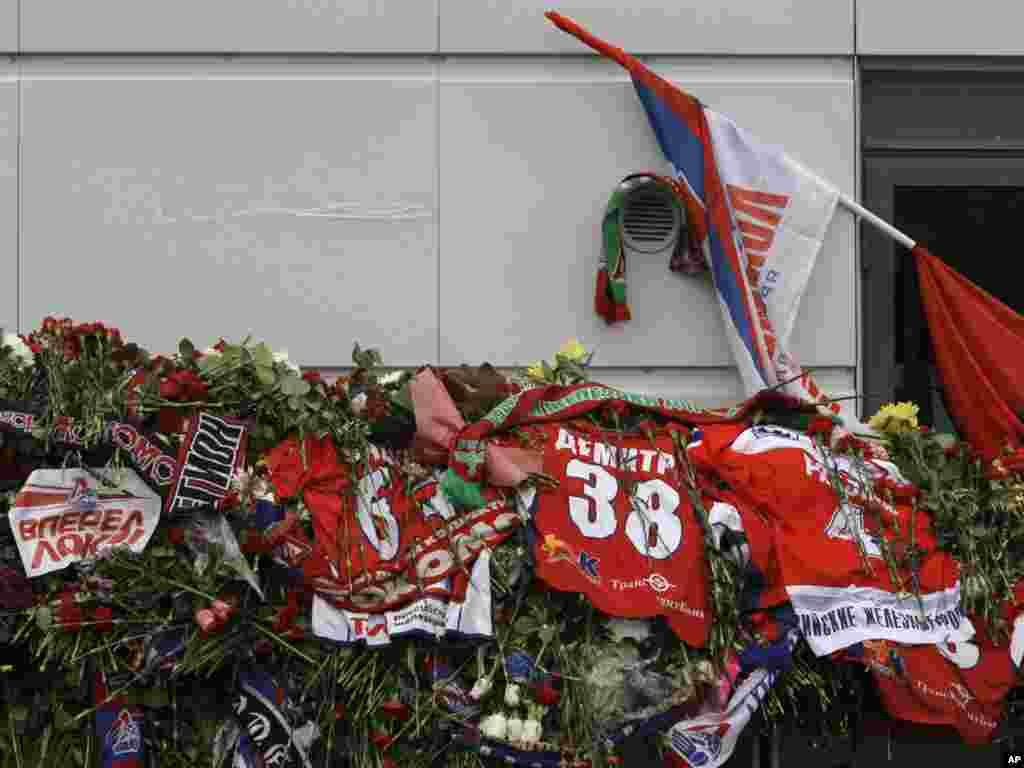 Thousands of flowers, team shirts, and flags are seen outside professional hockey team Lokomotiv Yaroslavl's arena in Yaroslavl on September 8. (Photo by Misha Japaridze for AP)