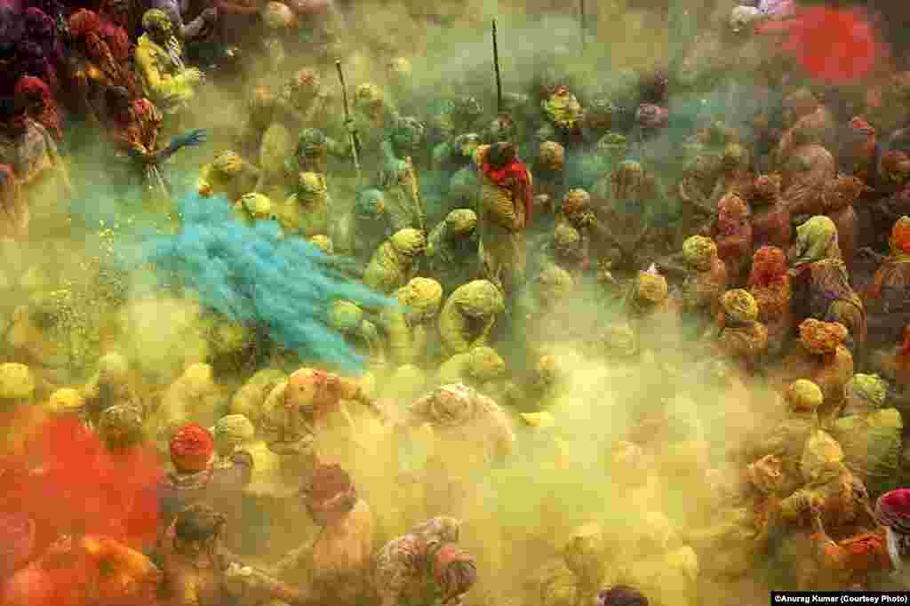 Photographer Anurag Kumar of India was selected in the Arts and Culture category for this shot of Holi, the Hindu festival of colors.