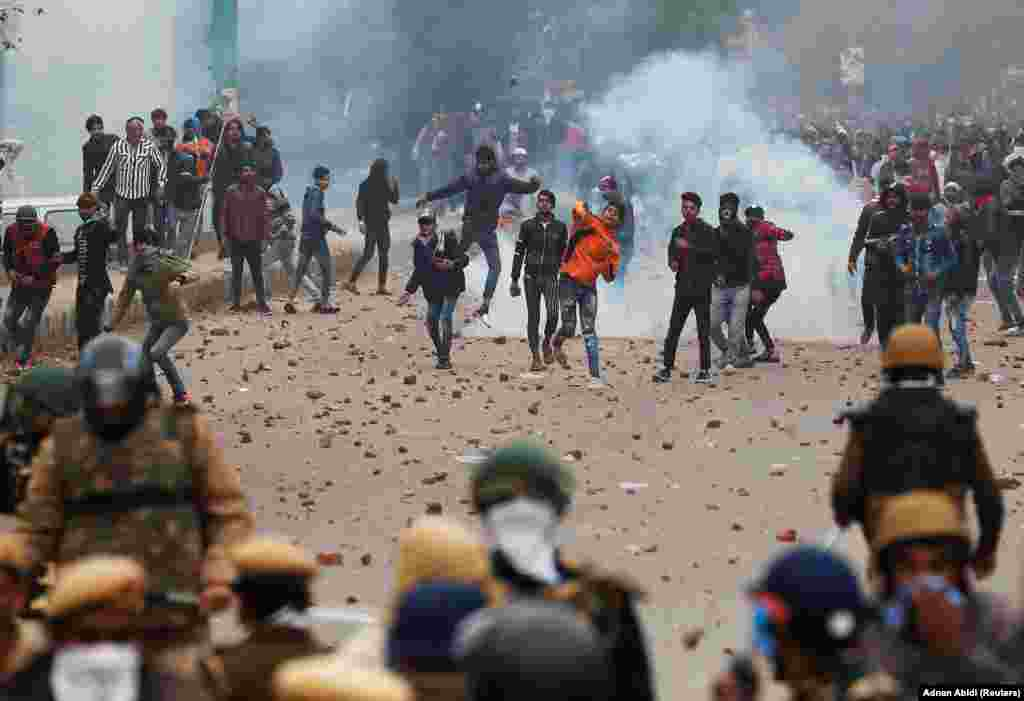 Demonstrators throw stone in Seelampur on December 17.