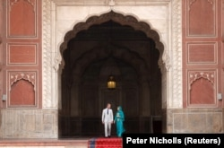 The royal couple in an archway of the Badshani Mosque in Lahore on October 17.