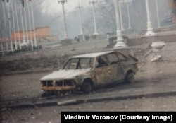 A bombed out car near Dudayev's makeshift presidential palace