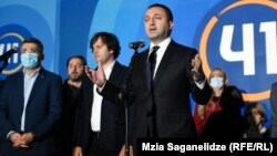 Prime Minister Irakli Gharibashvili celebrates after the polls close at a Georgian Dream rally in Tbilisi on October 2.