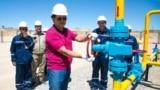 KazTransGas Chairman Kairat Sharipbaev (center) inaugurating new oil wells in Kazakhstan. (file photo)