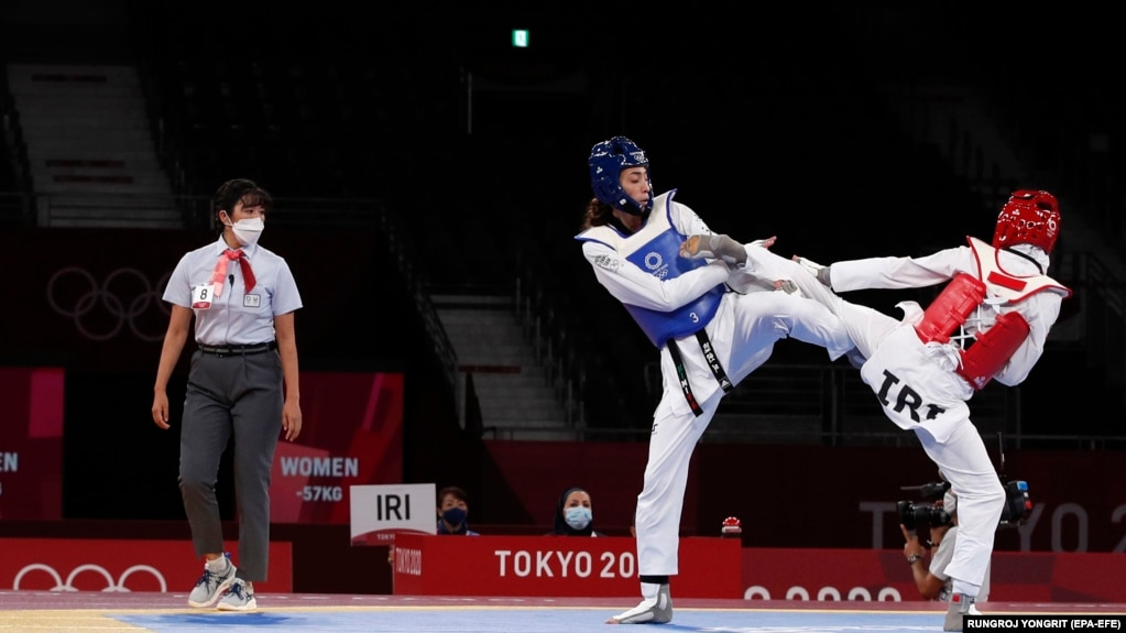 Kimia Alizadeh (left) in action during her first-round victory over compatriot Nahid Kiyani in the taekwondo women's under-57-kilogram competition at the Tokyo Olympics. She eventually made it to the semifinal stage, just missing out on emulating her bronze-medal finish at the 2016 games when she became the first Iranian woman to win an Olympic medal.