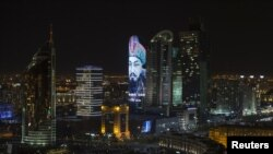 Kazakhstan -- A portrait of Kazakh historical figure Ablai Khan is projected on a building in downtown Astana, October 8, 2015