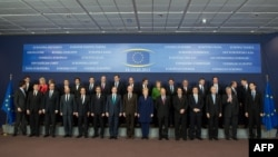 European Union leaders pose for group photo at EU headquarters in Brussels on March 14.