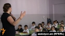 Armenia - A teacher holds a class at a school in Yerevan.