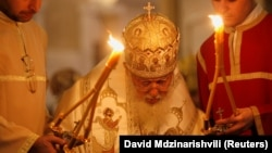 Georgian Patriarch Ilia II leads a midnight Christmas service at the Holy Trinity Cathedral in Tbilisi on January 7, 2018.