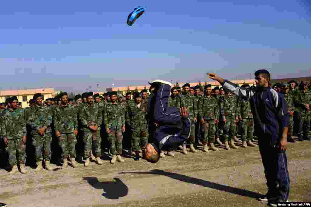An Afghan National Army soldier demonstrates his skills during a graduation ceremony at a military base in the Guzara district of Herat Province. (AFP/Hoshang Hashimi)
