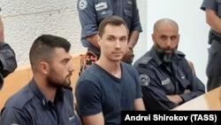 Russian citizen Aleksei Burkov (center) attends a court hearing in Jerusalem on November 3.