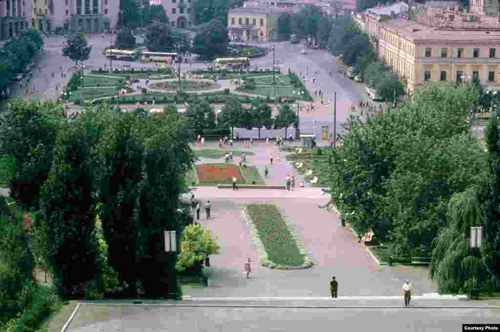 Kyiv's central square. It used to be known as Kalinin Square in 1963; in 1967 it was renamed October Revolution Square. Now it's Independence Square. The picture is taken from the podium of the then-Moscow Hotel, now known as the Ukraine Hotel. Only three buildings partly seen in the upper left corner remain today.