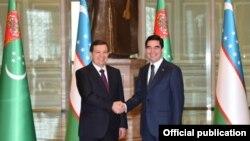 Гурбангулы Бердымухамедов и Шавкат Мирзияев, Ашхабад, 7 марта 2017 года