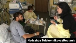 Pyotr Verzilov (left) speaks with ex-wife Nadezhda Tolokonnikova in his Berlin hospital room, where he was recovering from suspected poisoning.