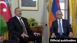 Azerbaijan's Ilham Aliev (left) and Armenia's Serzh Sarkisian meet in Geneva on October 16.