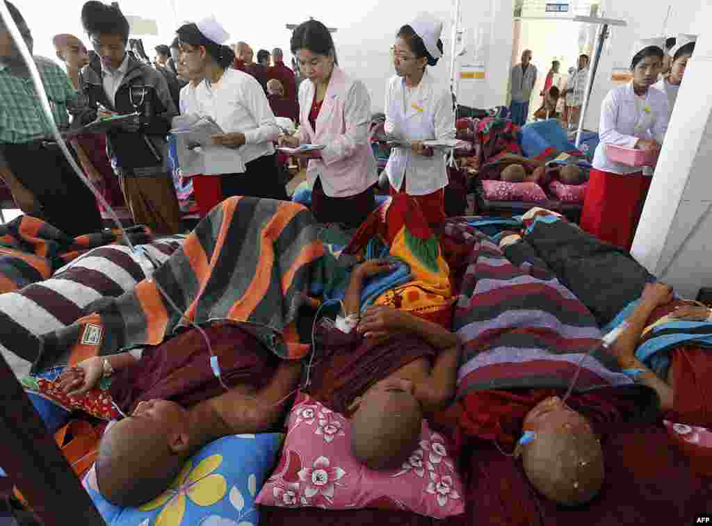 Buddhist monks receive treatment at a hospital after police fired water cannon and tear gas during a crackdown on villagers and monks protesting a Chinese-backed copper mine in northern Burma. (AFP/J Maung Maung)