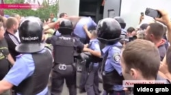 "Shouting ""Murderers!"" and spitting, punching, and demanding justice, hundreds of people converged on the district prosecutor's office, where the six officers were being transferred to a detention facility."