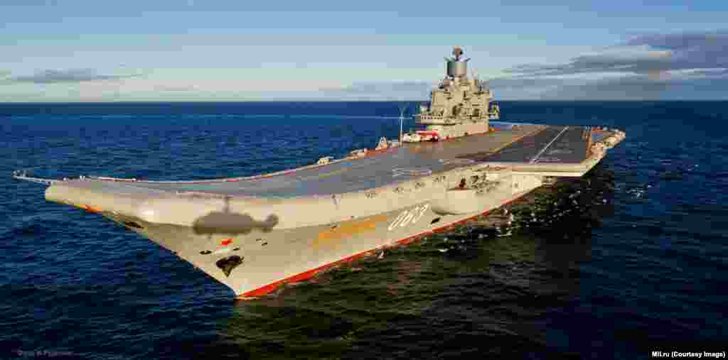 "The Admiral Kuznetsov relies on a ""ski jump"" runway to help lift planes skyward. The distinctive design ensures planes an upward trajectory even when the Admiral Kuznetsov heaves forward, but the lack of a catapult means the planes are limited in the amount of fuel, and weaponry, they can carry."