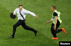 Verzilov is chased by a steward after he and other Pussy Riot members -- dressed in police uniforms -- ran onto the pitch during the World Cup final in Moscow on July 15.