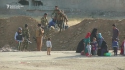Iraqi Civilians Flee Toward Liberating Forces