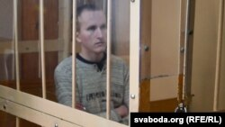 Uladzislau Kazakevich sits in court during his more recent trial last month.