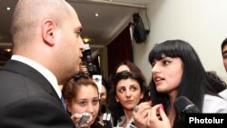 Armenia - Education Minister Armen Ashotian (L) is confronted by students at Yerevan State Linguistic University prtesting against the dismissal of its rector Suren Zolian, 19Apr2012.