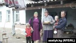 Евгений Андреев жана анын үй-бүлө мүчөлөрү.