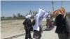 FILE: Taliban fighters in Ghazni during a brief ceasefire in May 2019.