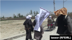 FILE: Taliban fighters in a ruler region of Afghanistan's Ghazni Province.