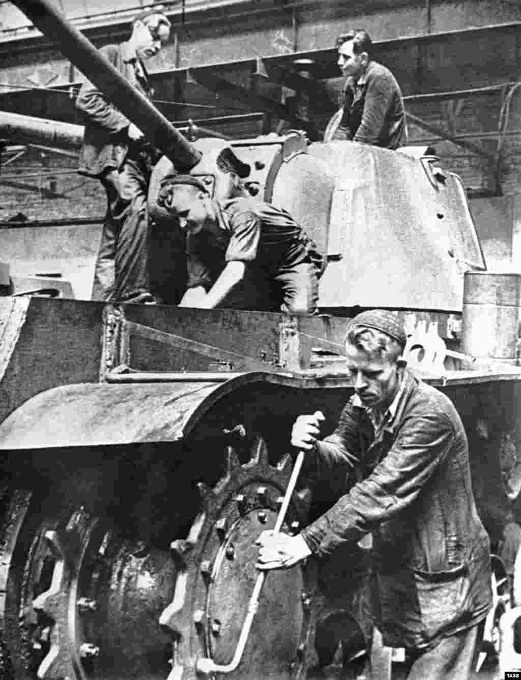 Workers assemble a T-34 tank in a workshop of the Kirov tank-manufacturing plant in Chelyabinsk, U.S.S.R., 1943.