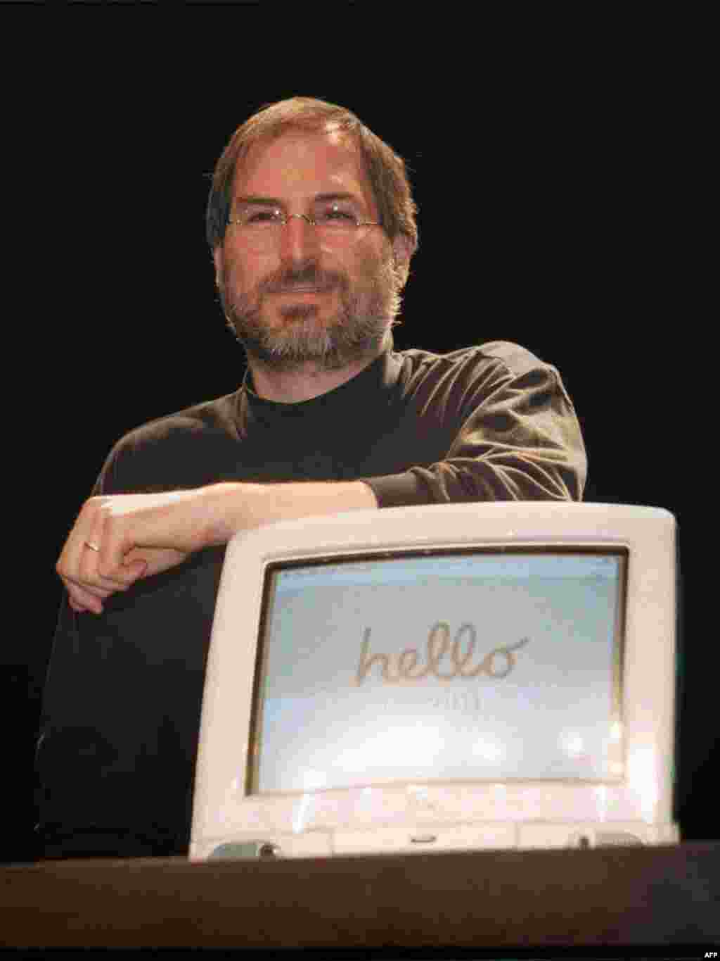 "Jobs' return to Apple in 1997, nearly a decade after breaking with management, rejuvenated the company. Here, Jobs introduces iMac computers at ""Apple Expo"" in Paris, France in 1998."