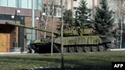 Pro-Russian separatists ride on a tank in the eastern Ukrainian city of Donetsk on February 15.
