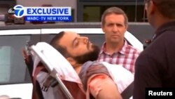U.S. - Ahmad Khan Rahami being loaded into an ambulance after a shoot-out with police in Linden, New Jersey, U.S., September 19, 2016