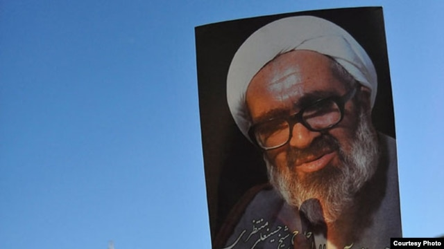 Iranians hold portraits of Iranian cleric Grand Ayatollah Hossein Ali Montazeri during his funeral procession in the holy city of Qom, 21Dec2009