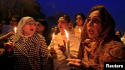 Members of civil society hold candle vigil for the victims of Peshawar school attack in Islamabad on December 22.