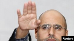 Саиф аль-Ислам, сын ливийского лидера Муаммара Каддафи. Триполи, 10 марта 2011 года.
