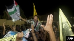 Палестынцы сьвяткуюць вызваленьне з турмы