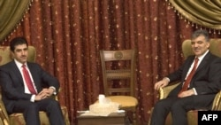 Nechirvan Barzani (left), the prime minister of the Kurdish Regional Government, meets with Turkish President Abdullah Gul in Baghdad on March 24.