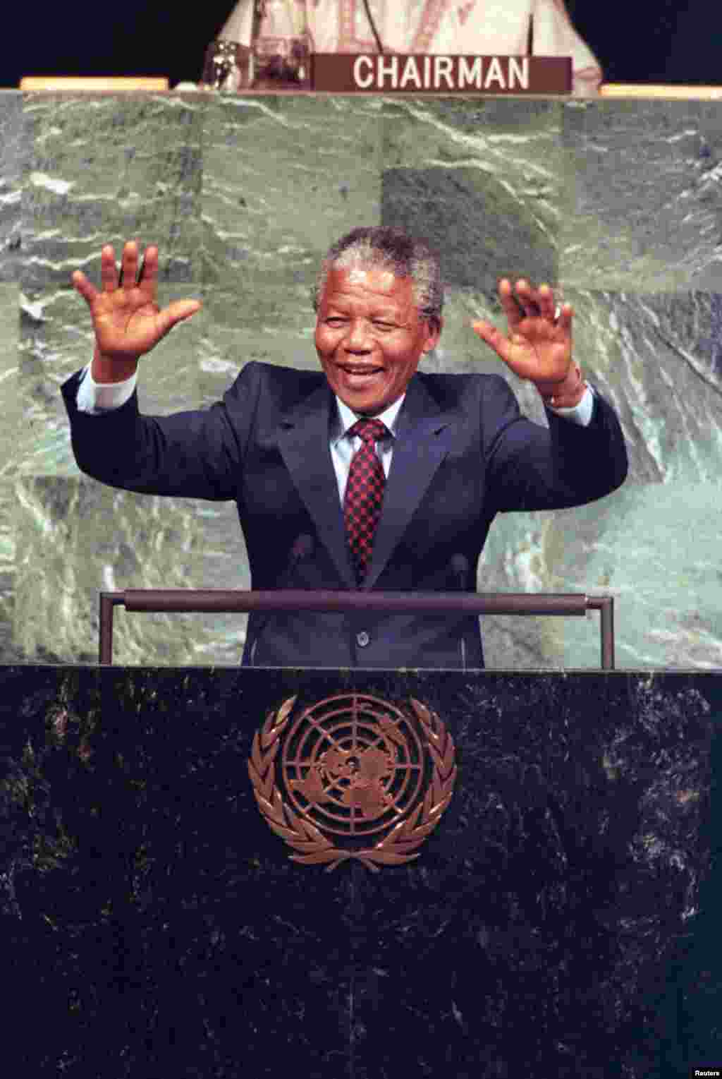 Nelson Mandela acknowledges the cheers of United Nations delegates during a speech to the UN Committee Against Apartheid in the General Assembly Hall in June 1990.