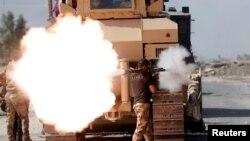 Pamje gjatë luftimeve të forcave speciale irakiane kundër militantëve të Shtetit Islamik në pjesën lindore të Mosulit
