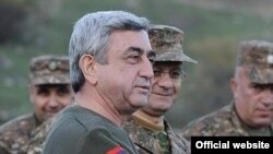 Armenian President Serzh Sarkisian visits military exercises held by Karabakh Armenian troops on November 12.