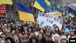 Students from different educational institutions shout slogans during their march in Kyiv on November 26.