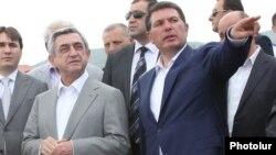 Armenia - President Serzh Sarkisian and Environment Minister Aram Hartiunian (R), June 29, 2011.