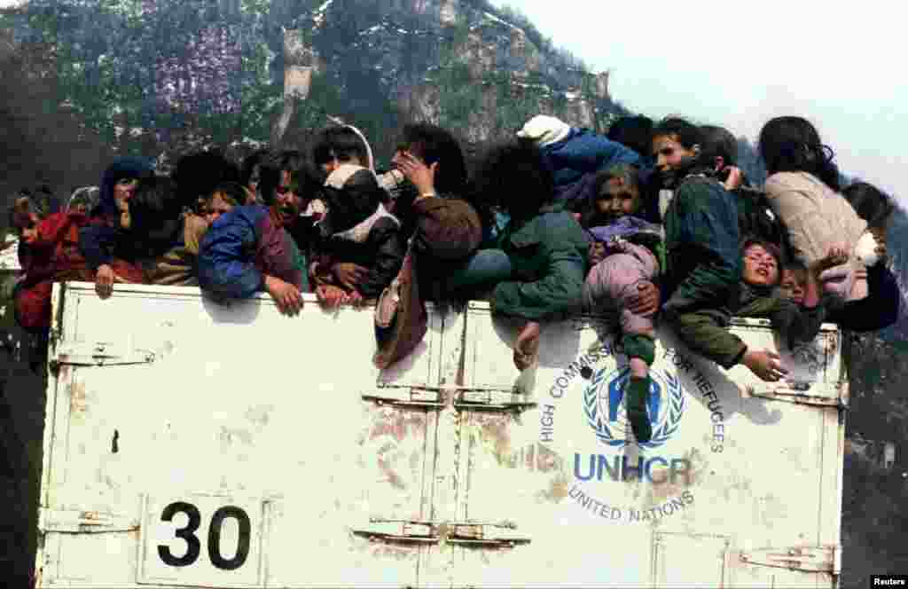 Bosnian Muslim refugees are packed into a UNHCR truck on March 31, 1993, during the evacuation of the besieged town of Srebrenica.  An enclave in the east of the town was designated a U.N. safe haven, but four months later, in July, more than 8,000 Muslim men and boys would be slaughtered in Europe's worst massacre since World War II.