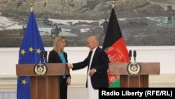 European Union foreign policy chief Federica Mogherini (left) shaking hands with the Afghan President Ashraf Ghani during a press conference at the presidential palace in Kabul on March 26.