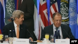 Talking Syria -- U.S. Secretary of State John Kerry and Russian Foreign Minister Sergei Lavrov in New York on December 18.