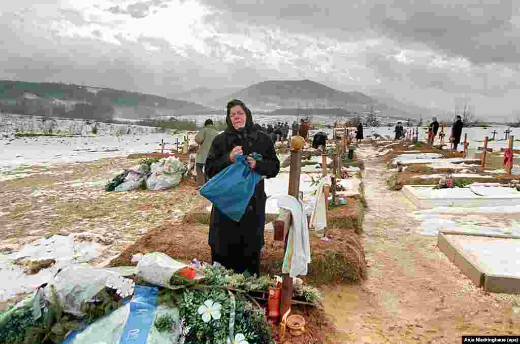 Melica Saric, a Bosnian Serb mother, mourns at the grave site of her son Velimir on December 24, 1995, in Sarajevo. He was killed near the end of the war in October near the front line of Sarajevo's Serb-held suburbs.